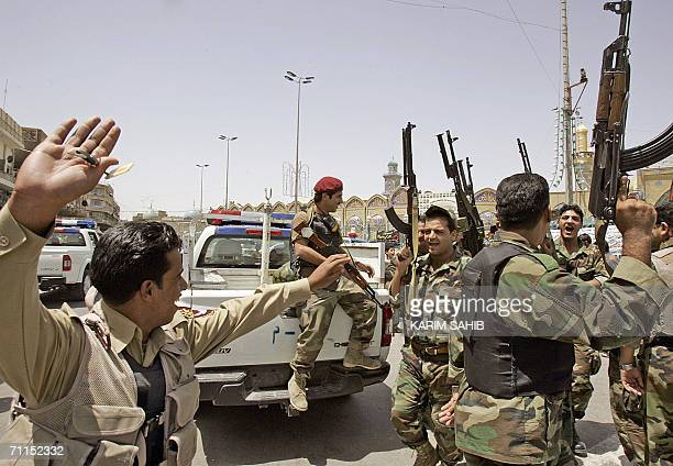 Iraqi soldiers jubilate in Baghdad after hearing Iraqi Prime Minister Nuri alMaliki announcing 08 June 2006 the death of alQaeda leader in Iraq Abu...