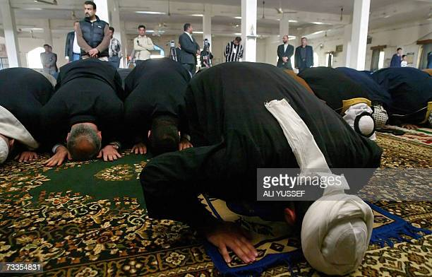 Iraqi Sunni and Shiite clerics and tribesmen pray at a Sunni mosque after reopening it in a Shiite neighbourhood in Baghdad 17 February 2007 Attacks...