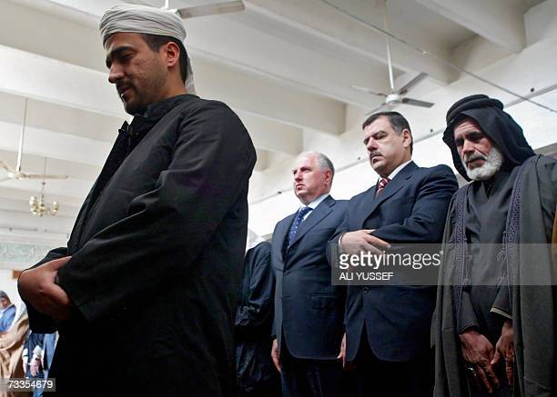 Iraqi Sunni and Shiite clerics tribesmen and officials pray at a Sunni mosque after reopening it at in a Shiite neighbourhood in Baghdad 17 February...