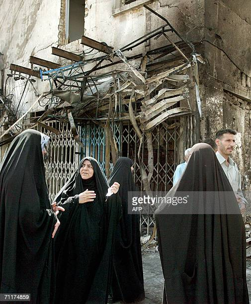 Iraqi women react as they inspect 11 June 2006 the site where a car bomb exploded yesterday in central Baghdad Three Iraqis were killed in violence...