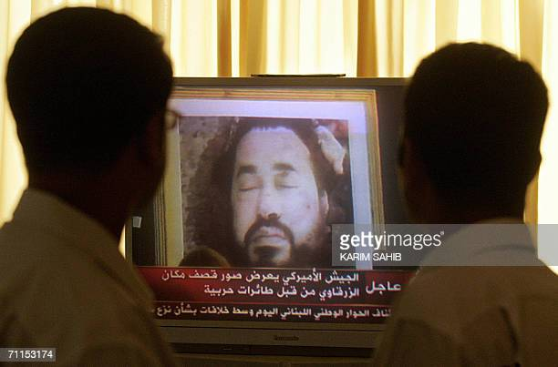 Iraqis looks at an image made avilable by the US Army 08 June 2006 of slain AlQaeda chief in Iraq Abu Musab alZarqawi who was killed in a joint...