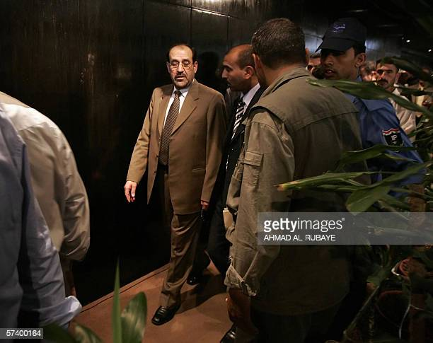 Iraq's new Prime Minister Designate Jawad alMaliki walks out of a parliament session held in Baghdad's heavily fortified Green Zone 22 April 2006...