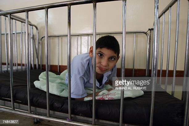 Mohammed Ismail a twelveyearold orphan sits inside his bed after he was transferred to 'Dar alHanan' orphanage for girls 21 June 2007 Mohammed was...
