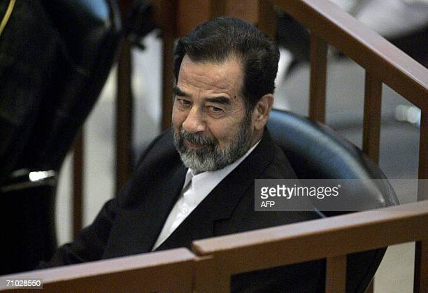 Ousted Iraqi dictator Saddam Hussein attends his trial held in Baghdad's heavily fortified Green Zone, 24 May 2006. The trial of deposed Iraqi...