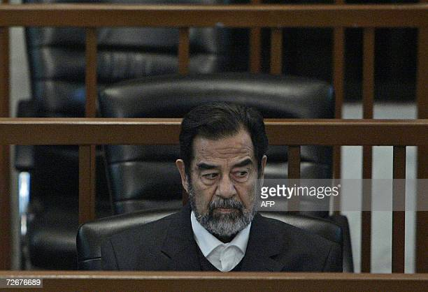 Ousted Iraqi President Saddam Hussein sits in court during the continuation of the ' Anfal' trial in Baghdad 30 November 2006 In the genocide trial...