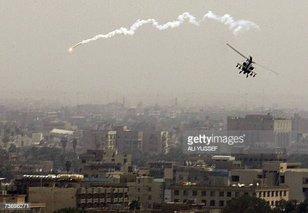 PROECTIV REPEAT A US army Apache helicopter drops flares as it flies over Baghdad 25 March 2007 US Vice President Dick Cheney has assured political...