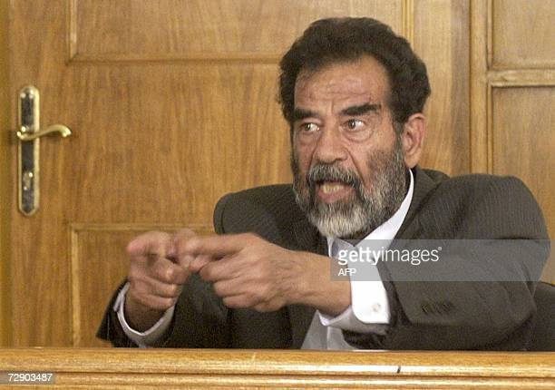 This 01 July 2004 file photo shows former Iraqi dictator Saddam Hussein addressing a court in Baghdad during his first appearance before a judge to...
