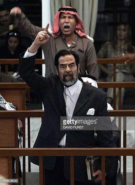 This 05 December 2005 file photo shows former Iraqi president Saddam Hussein and his half brother Barzan Ibrahim al-Tikriti berating the court during...