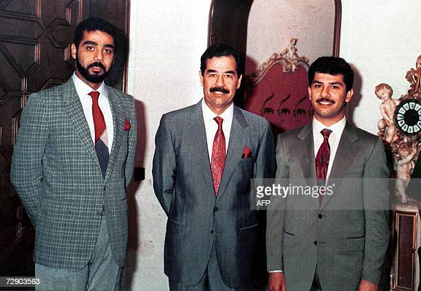 This file photograph dated 1992 shows Iraqi President Saddam Hussein with his two sons Uday and Qusay in Baghdad Ousted Iraqi leader Saddam Hussein...