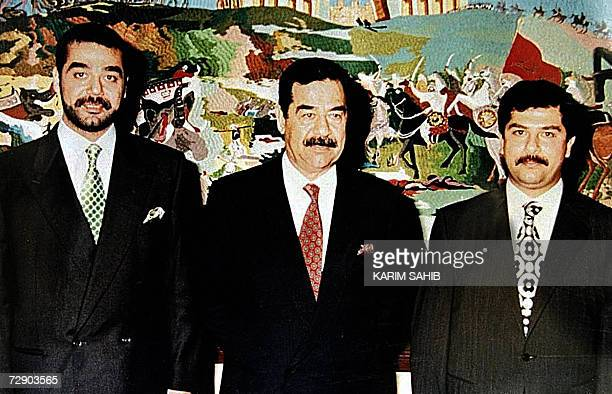 This undated file photograph shows Iraqi President Saddam Hussein with his sons Uday and Qussay in Baghdad Ousted Iraqi leader Saddam Hussein was...