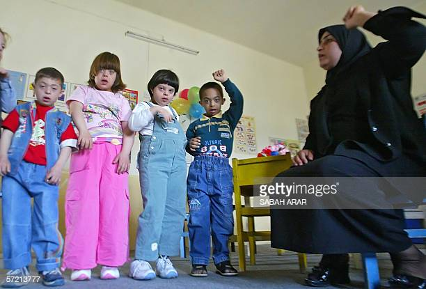 TO GO WITH AFP STORY IRAQUNRESTCHILDREN Iraqi children with Down Syndrome follow the acts of a teacher at alRajaa Institute for Special Needs 27...