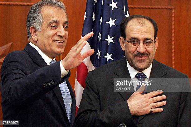TO GO WITH AFP STORYIRAQYEAR2006 Iraqi Prime Minister Nuri alMaliki places his hand on his heart in thanks and respect and US Ambassador to Iraq...