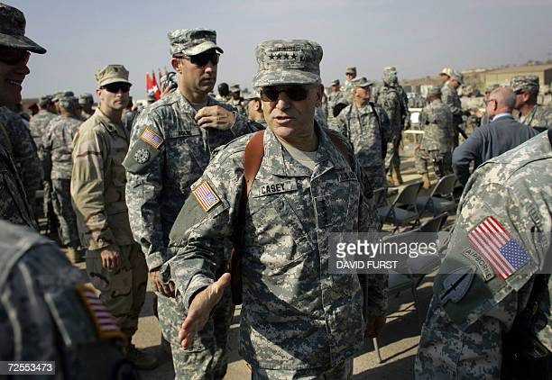 Top US commander in Iraq General George Casey shakes hands with soldiers following a handover ceremony from the 4th Infantry Division to the 1st...
