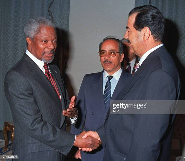 UN SecretaryGeneral Kofi Annan gestures as he is welcomed by Iraqi President Saddam Hussein in Baghdad 22 February 1998 Ousted Iraqi dictator Saddam...
