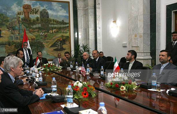 US Ambassador to Iraq Ryan Crocker and his Iranian counterpart Hassan Kazemi attend a meeting on security in Iraq at Iraqi Prime Minister Nuri...