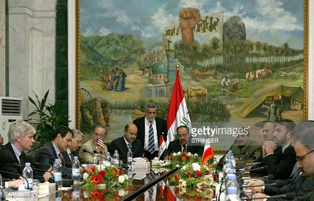 US Ambassador to Iraq Ryan Crocker faces Iranian ambassador Hassan Kazemi and the Iranian delegation as Iraqi Prime Minister Nuri alMaliki speaks...