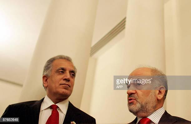 Ambassador to Iraq Zalmay Khalilzad and Iraqi outgoing Prime Minister Ibrahim al-Jaafari chat with each other at Mr. Khalilzad's residence late 18...