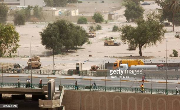 US armoured vehicles secure the area where two car bombs exploded in a parking lot nearby the Green Zone area in central Baghdad 24 April 2007 US...