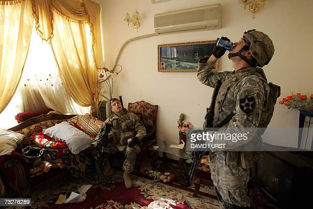Army soldiers from Bravo Company 5-20 Infantry Regiment take a break in an Iraqi home as they clear through the Adamiyah neighborhood of northern...