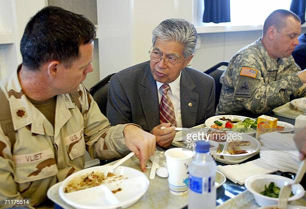US Senator Daniel Kahikina chats with US Major Vliet as they have lunch in Baghdad's heavily Fortified Green Zone 11 June 2006 US military doctors...