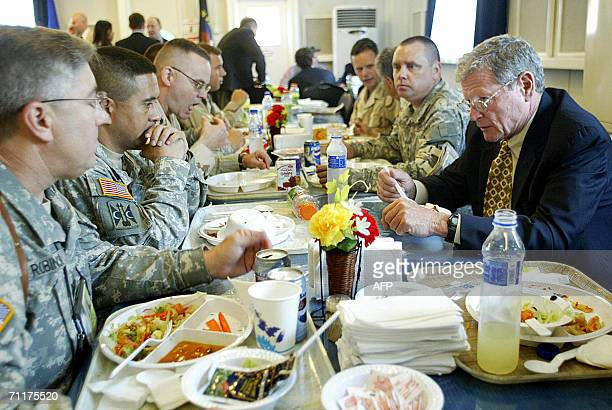 US Senator James Mountain chats with US officers as they have lunch in Baghdad's heavily Fortified Green Zone 11 June 2006 US military doctors...