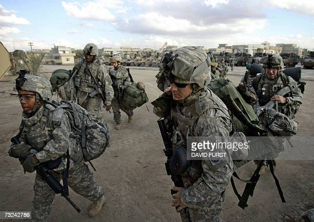 Soldiers from the 2-325 82nd Airborne Division move their equipment into a combat outpost set up in the restive Adhamiyah neighborhood of northern...