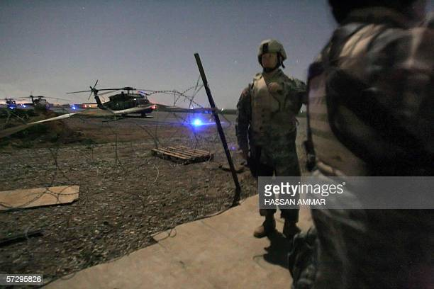 US soldiers wait in line at a helipad to be transported between military bases near Kirkuk north of Baghdad early 10 April 2006 The US military is...