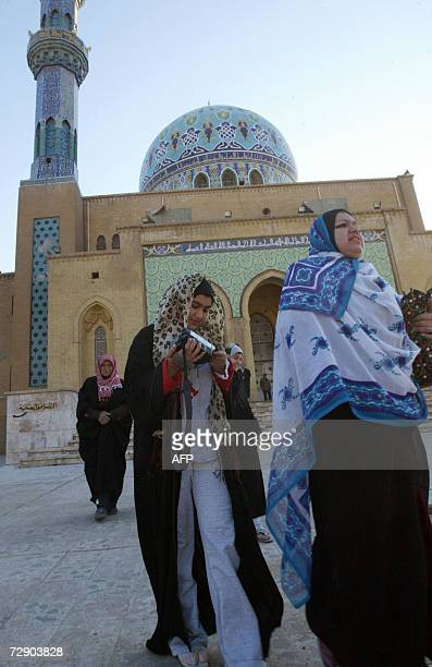 Women worshippers leave the Sunni 14 Ramadan mosque in central Baghdad after Eid AlAdha or Feast of Sacrifice early morning prayers 30 December 2006...