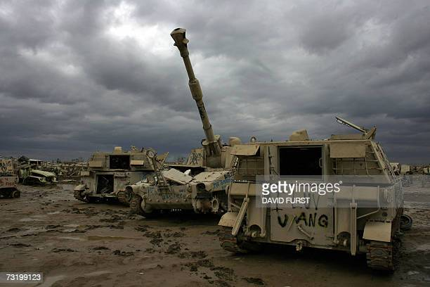 Wreckage of Saddam Husseinera tanks and artillery are seen in a junkyard adjacent to a US military forward operating base located on the outskirts of...