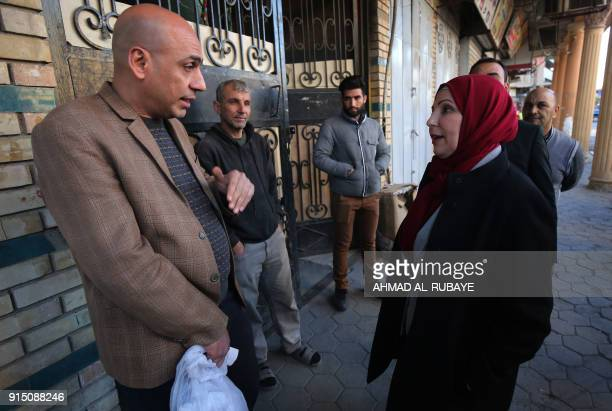 Baghdad Mayor Thikra Alwash 60yearold civil engineer and only woman mayor of a Middle East capital speaks to civilians during a tour at alRashid...