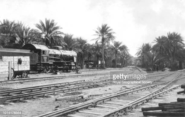 Baghdad railway Tracks with engine in the background Gertrude Bell visited Iraq in 1909 191314 and 19161918 this photo is likely to date from her...
