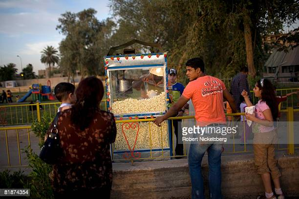 Baghdad residents gather in the Abu Niwas Street park winding along the Tigris River on May 29 2008 in central Baghdad Iraq With the hot weather and...