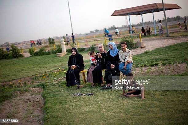 Baghdad residents gather in the Abu Niwas Street park winding along the Tigris River on May 28 2008 in central Baghdad Iraq With the hot weather and...