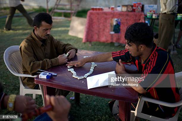 Baghdad residents gather in the park along Abu Niwas Street winding along the Tigris River on May 29 2008 in central Baghdad Iraq With the hot...