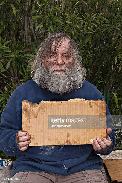 bagman with a blank sign - homeless veterans stock photos and pictures