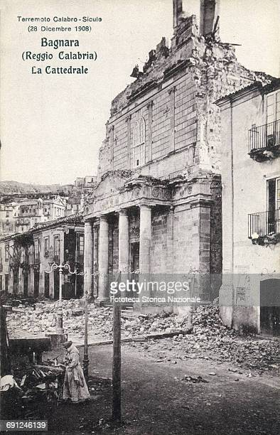 Bagnara the Cathedral rubble A woman with folded arms looking a pile of debris The terrible earthquake of magnitude 72 which counted between 90000...