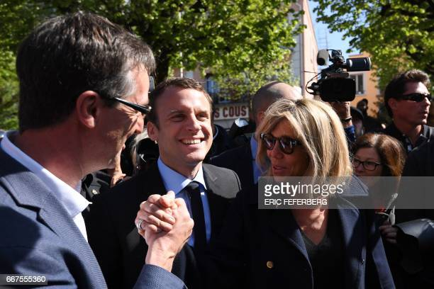 TOPSHOT BagneresdeBigorre mayor Jean Bernard Sempastous welcomes French presidential election candidate for the En Marche movement Emmanuel Macron...
