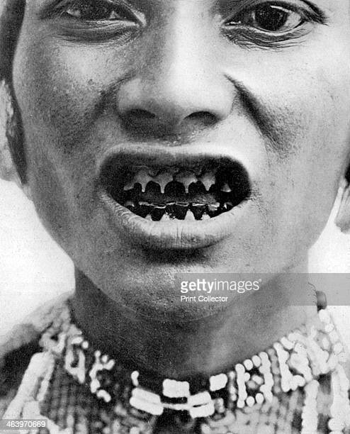 A Bagobo with filed teeth circa 1910 The Bagobo are a people of southern coastal Mindanao in the Philippines A print from 'Customs of the World...