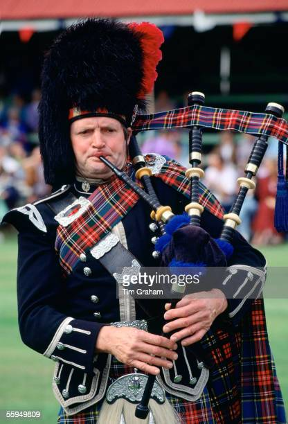 Bagpipe player at the Braemar Games Scotland