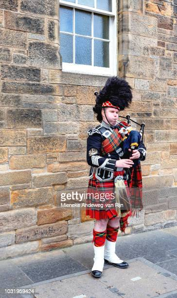 Bagpipe player in traditional Scottish outfit