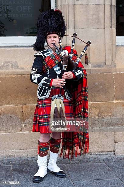 Bagpipe player performing on Royal Mile, Edinburgh, Scotland, United Kingdom,