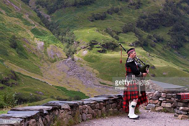 bagpiper in glencoe. - grampian scotland stock pictures, royalty-free photos & images