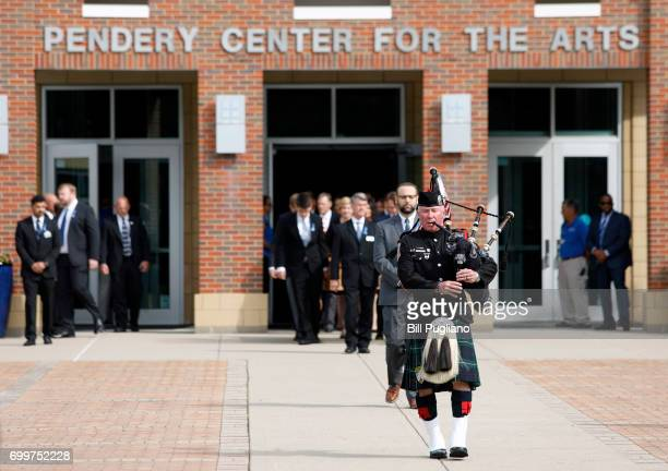 A bagpiper leads the casket of Otto Warmbier is carried out from his funeral at Wyoming High School June 22 2017 in Wyoming Ohio Otto Warmbier the...