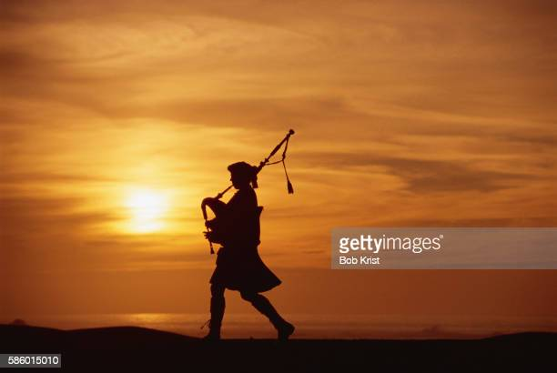 Bagpiper Playing at Sunset
