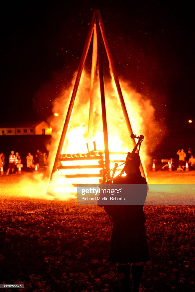 A Bagpiper plays as a Funeral Pyre burns on The Toxteth Day of The Dead as The Justified Ancients of Mu Mu Present 'Welcome To The Dark Ages' on August 25, 2017 in Liverpool, England.