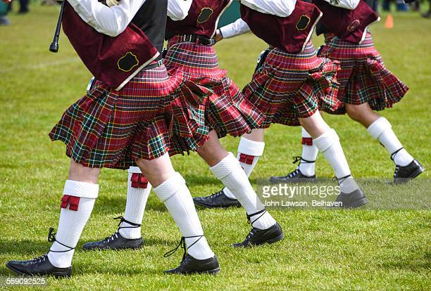 Bagpiper's kilts being blown by the wind