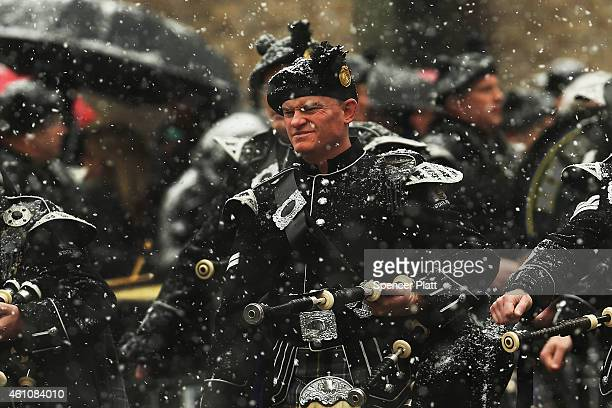 Bagpipers lead the procession of the hearse carrying the casket of former threeterm governor Mario Cuomo into St Ignatius Loyola Church on January 6...