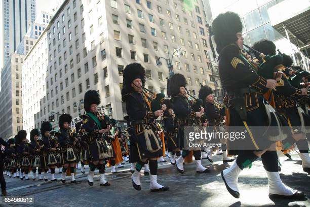 Bagpipers play as they march along 5th Avenue during the annual St Patrick's Day parade March 17 2017 in New York City The New York City St Patrick's...