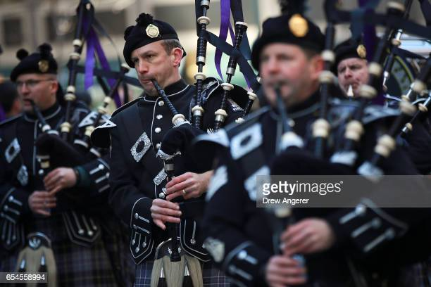 Bagpipers play as they march during the annual St Patrick's Day parade on 5th Avenue March 17 2017 in New York City The New York City St Patrick's...
