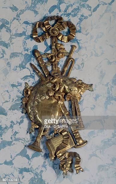 Bagpipes decorative element in gilded wood Music room Chateau de Ravel Auvergne France